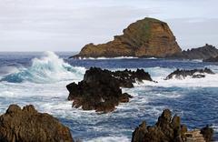 Waves, lava stone, porto moniz, madeira, portugal, europe Stock Photos