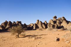 Rock formations in the libyan desert, wadi awis, akakus mountains, libya, nor Stock Photos