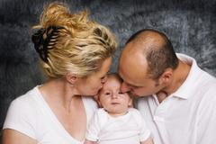 Family with mother, 34 years, baby, 2 months and father, 37 years Stock Photos