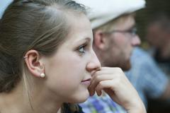 a young man and a young woman looking a bit bored, germany, europe - stock photo