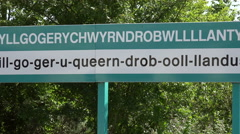 Zoom out, one of the longest village names in the world, llanfairpwll, Wales Stock Footage