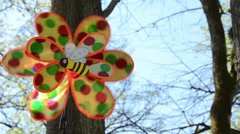 Close of child plastic wind toy spin against sky Stock Footage