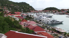 St Bart harbor and expensive luxury yachts Stock Footage