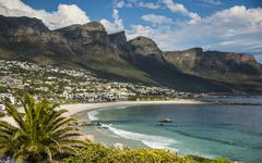 Camps Bay with the Twelve Apostles mountain range Cape Peninsula Cape Town - stock photo