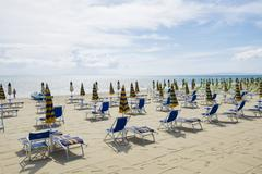 Deck chairs on the beach Follonica Province of Grosseto Tuscany Italy Europe Stock Photos