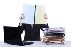 Businesswoman reads documents Stock Photos