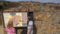 Tourists visit parys mountain copper mine, amlwch, anglesey, north wales, uk Stock Footage
