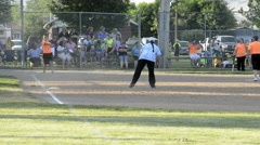 Spectators watch small town annual coed softball tournament - stock footage