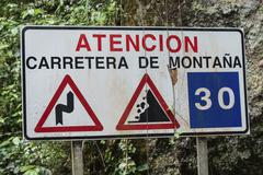 Spanish warning sign of dangers in the mountains Barranco del Agua canyon Stock Photos