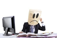 stressful anonymous businessman in office - stock photo