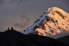 Stock Photo of Summit of Mount Kazbek with Zminda Sameba pilgrims monastery High Caucasus