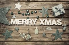 Merry xmas: christmas greeting card with blue and white decoration on wood. Kuvituskuvat