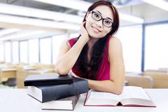 student study at the library - stock photo