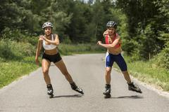 Young women 19 years inline skating country road Schurwald Baden Wurttemberg - stock photo