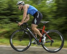 Triathlete 45 years cycling Kaiserstrassle road Baden Wurttemberg Germany - stock photo