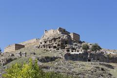 Acropolis with Lycian rock tombs and fortress ancient city of Tlos in the Stock Photos