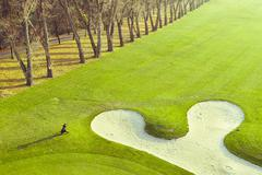 beautiful golf course with the sand bunker - stock photo