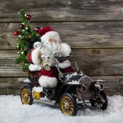 Christmas decoration: red santa claus in hurry to buy christmas presents on w Stock Photos