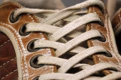 Laces of a leather shoe Stock Photos