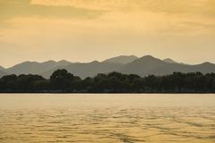 Hills at West Lake at sunset Xihu Hangzhou Zhejiang Province China Asia - stock photo