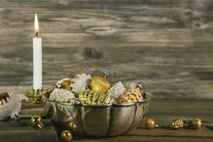 first advent: christmas decoration in gold and silver with a white burning ca - stock photo