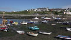 Pan, boats at low water, cemaes bay and harbour, anglesey, north wales, uk Stock Footage