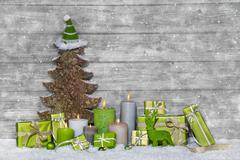 Shabby chic green and white christmas decoration on grey wooden background wi Stock Photos