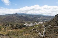 Winding road volcanic landscape Santiago del Teide Tenerife Canary Islands - stock photo