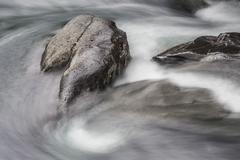 Rocks in the Abiskojakka river Abisko National Park Norrbotten County Sweden - stock photo