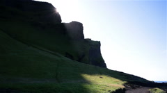 Sunbreak over green grassy mountain in iceland Stock Footage