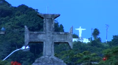 Maltese cross with statue of christ on the background - stock footage