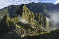 Inca ruins of Machu Picchu in the morning light UNESCO World Cultural Heritage - stock photo