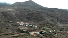 Spain The Canary Islands Tenerife 024 volcanic landscape with village in valley Stock Footage