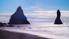 Reynisdrangar, Iceland, pyramid shaped rocks rising through ocean 4k Stock Footage
