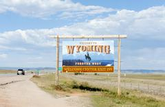 Stock Photo of Welcome sign on a highway Welcome to Wyoming Forever West flat landscape