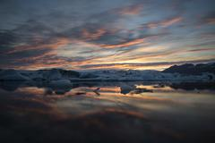 Icebergs Jokulsarlon Glacier Lagoon in the afterglow Vatnajokull Glacier - stock photo