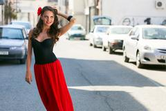 Spanish woman in black dress is posing in the town Stock Photos
