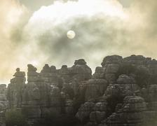 Bizarre limestone rock formations with the sun and fog El Torcal Nature Reserve Stock Photos
