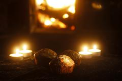 Chocolate muffins and tea light candles Stock Photos