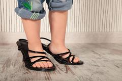 Child in heels Stock Photos