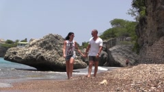 Couple walking on the beach at Westpunt Slo Mo Stock Footage