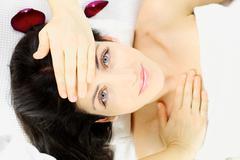 Happy beautiful woman laying in spa Stock Photos