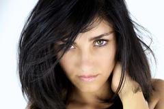 serious young woman looking with green eyes - stock photo