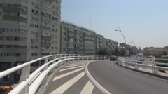 Suspended highway in big city, no cars driving on street over the town sunny day Stock Footage