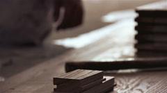 Carpenter worker installing wood parquet board during flooring Stock Footage