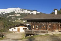 Mountain cabins Buchenauer Alm alp Kurzer Grund region Tyrol Austria Europe - stock photo