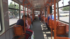 Perfect shot inside public transport, people in tram interior traveling downtown Stock Footage