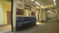 Great shot subway train stationary in station, no people inside, doors opened Stock Footage