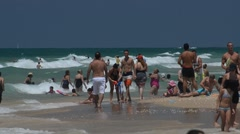 Plenty of people of holiday-makers at the Mediterranean seaside - stock footage