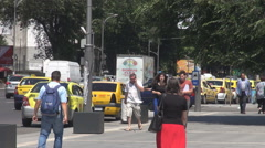 Summer days downtown, people walk relaxed near cabs station, movement on road Stock Footage
